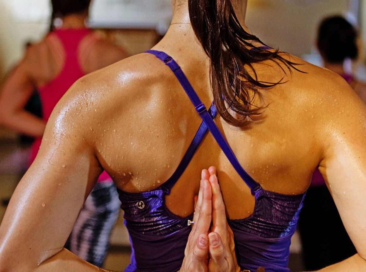 Girl Doing Hot Yoga With Yoga Mat in Background
