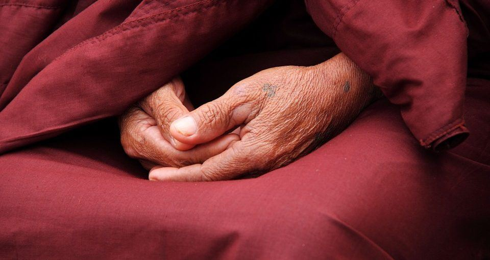 Hand of monk who is meditating