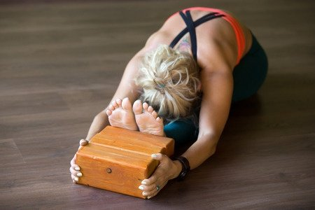 Woman using a Yoga Block
