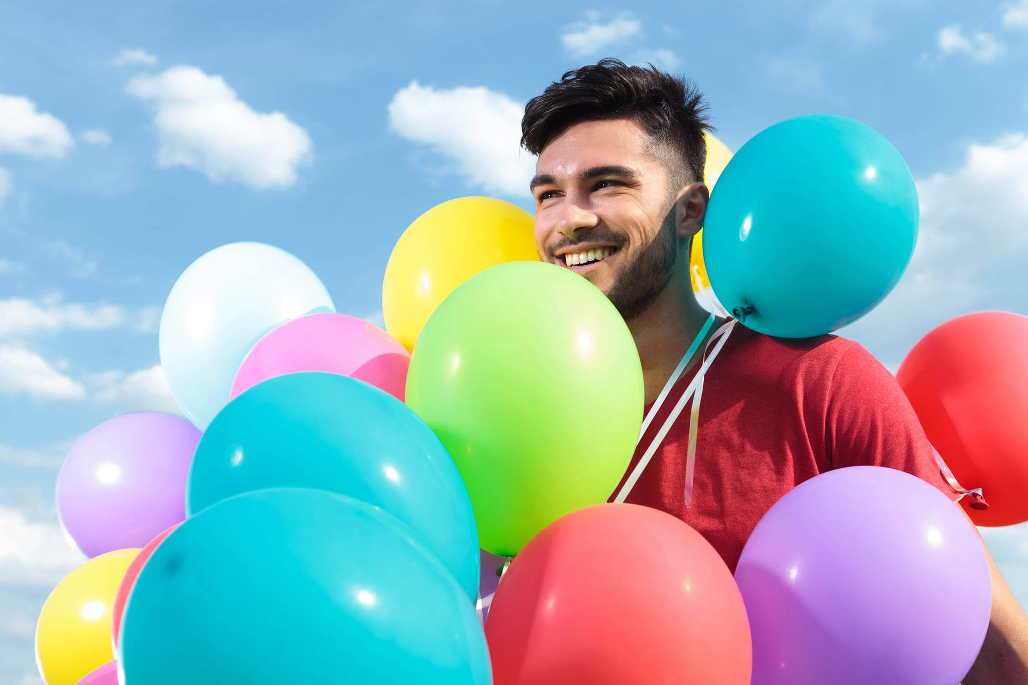 spiritual man with balloons all over him