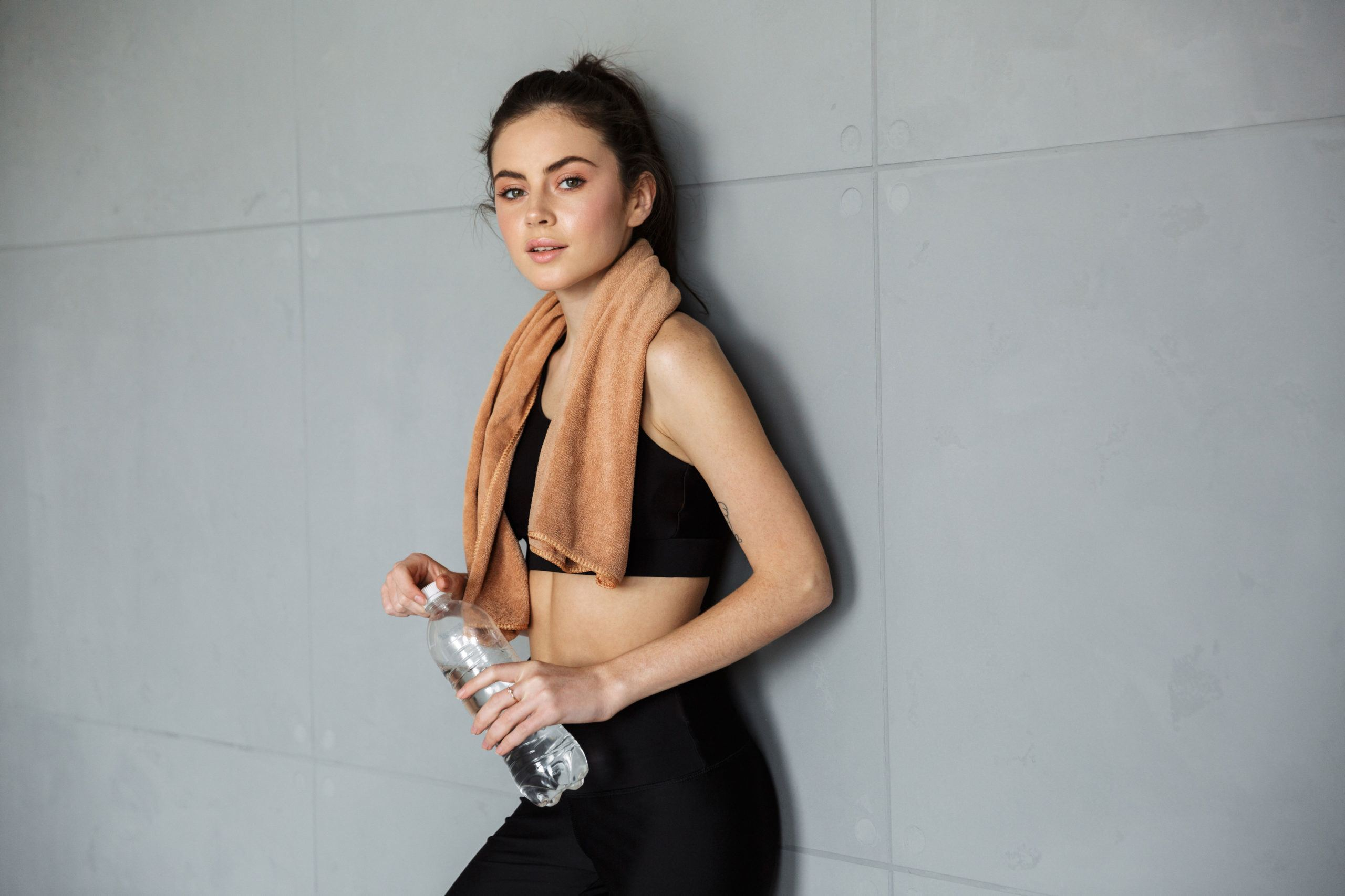 Woman with towel after hot yoga class